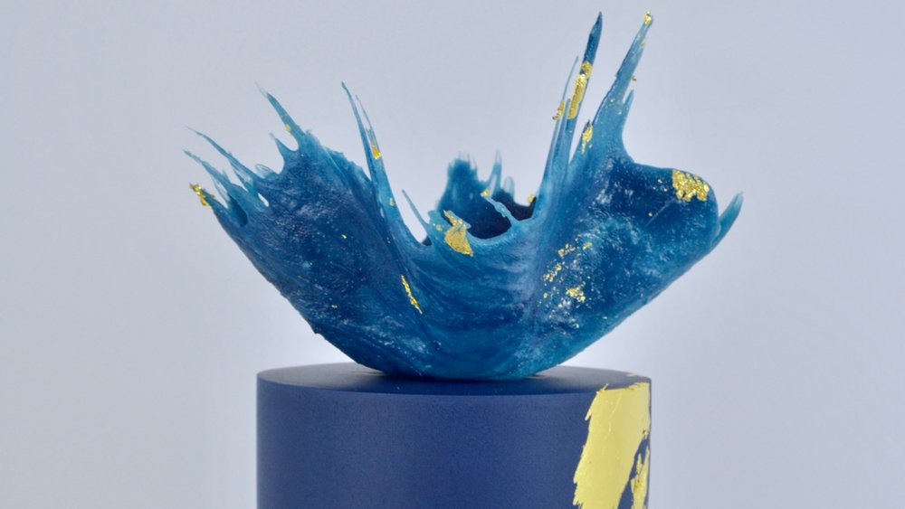 Midnight Gold - A vibrant blue sugar 'splash' atop a cool midnight blue cake with splashes of edible gold leaf for a luxuriously stylish celebration cake