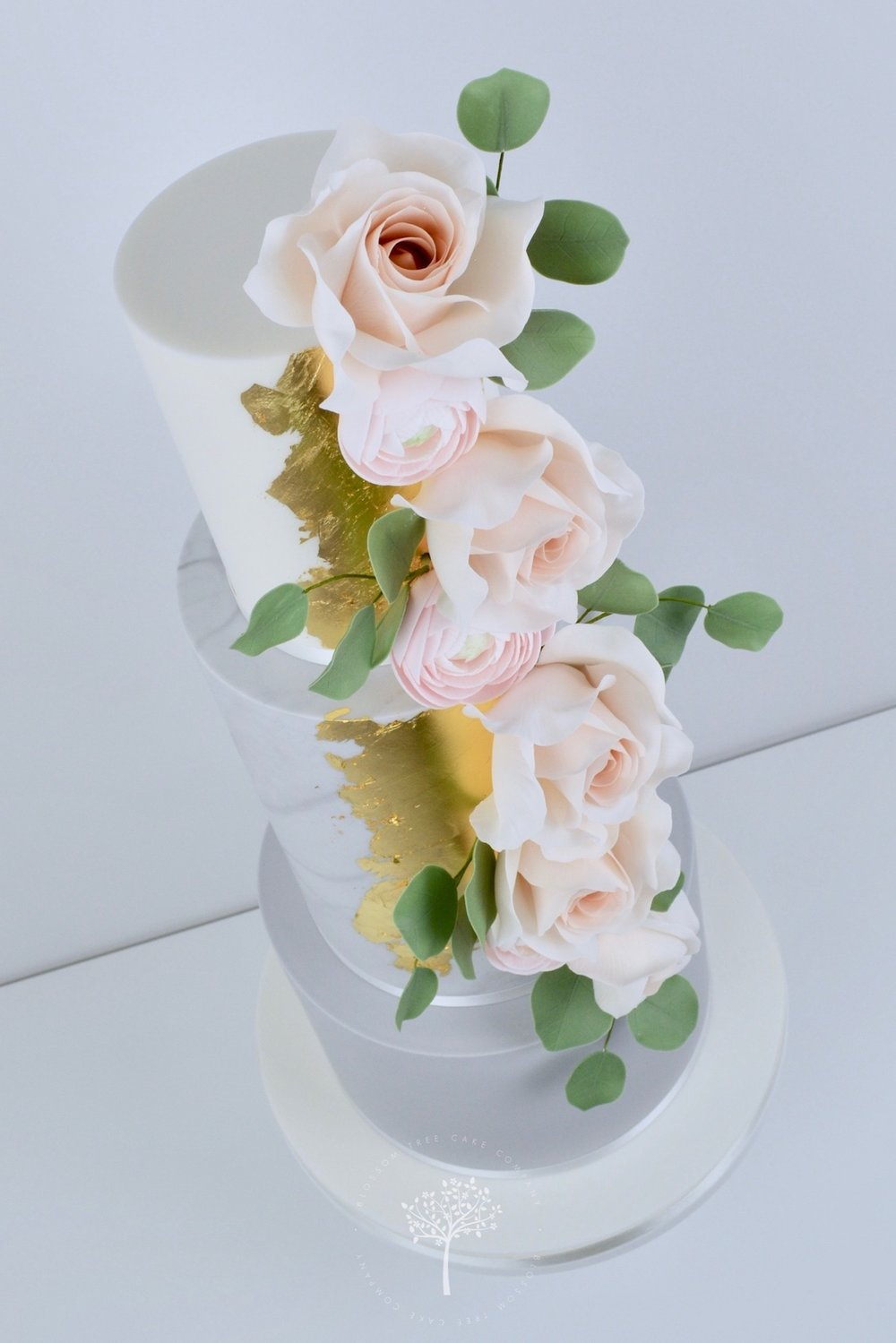 Rose Gold and Ranunculus wedding cake by Blossom Tree Cake Company Harrogate North Yorkshire - angle.jpg
