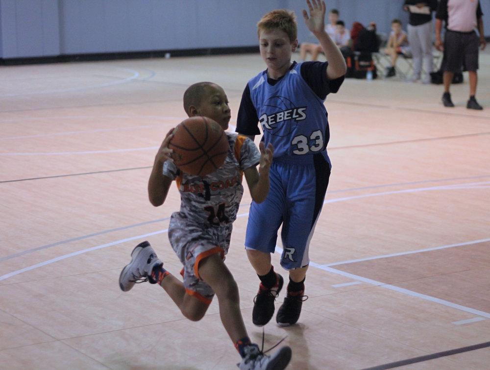 AAU driving to basket.jpg