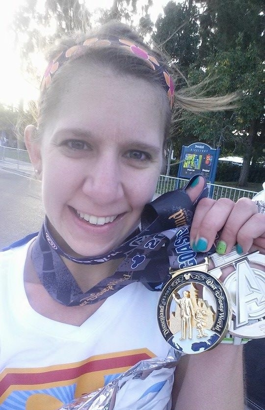 Holding up both the Avengers Half Marathon and Coast to Coast medals!