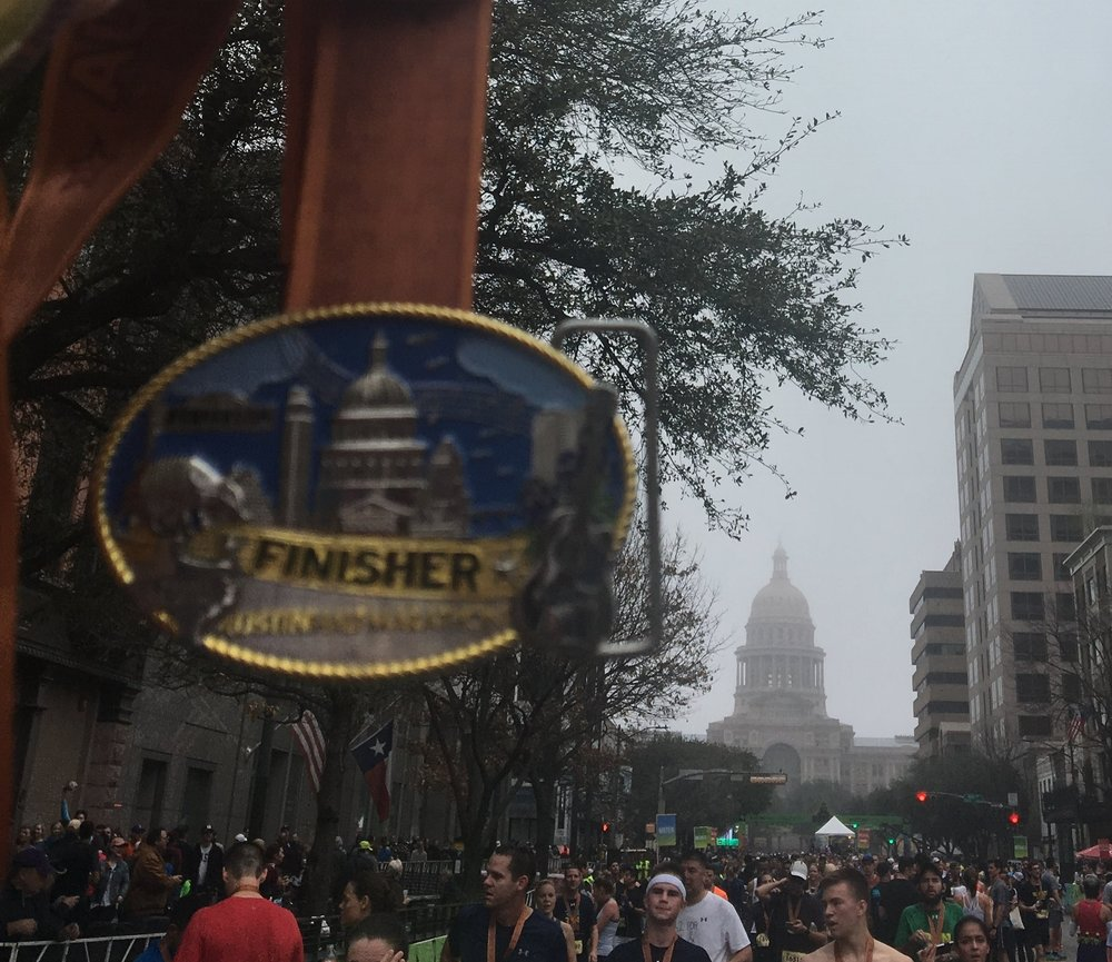 Finisher medal with the State Capital.
