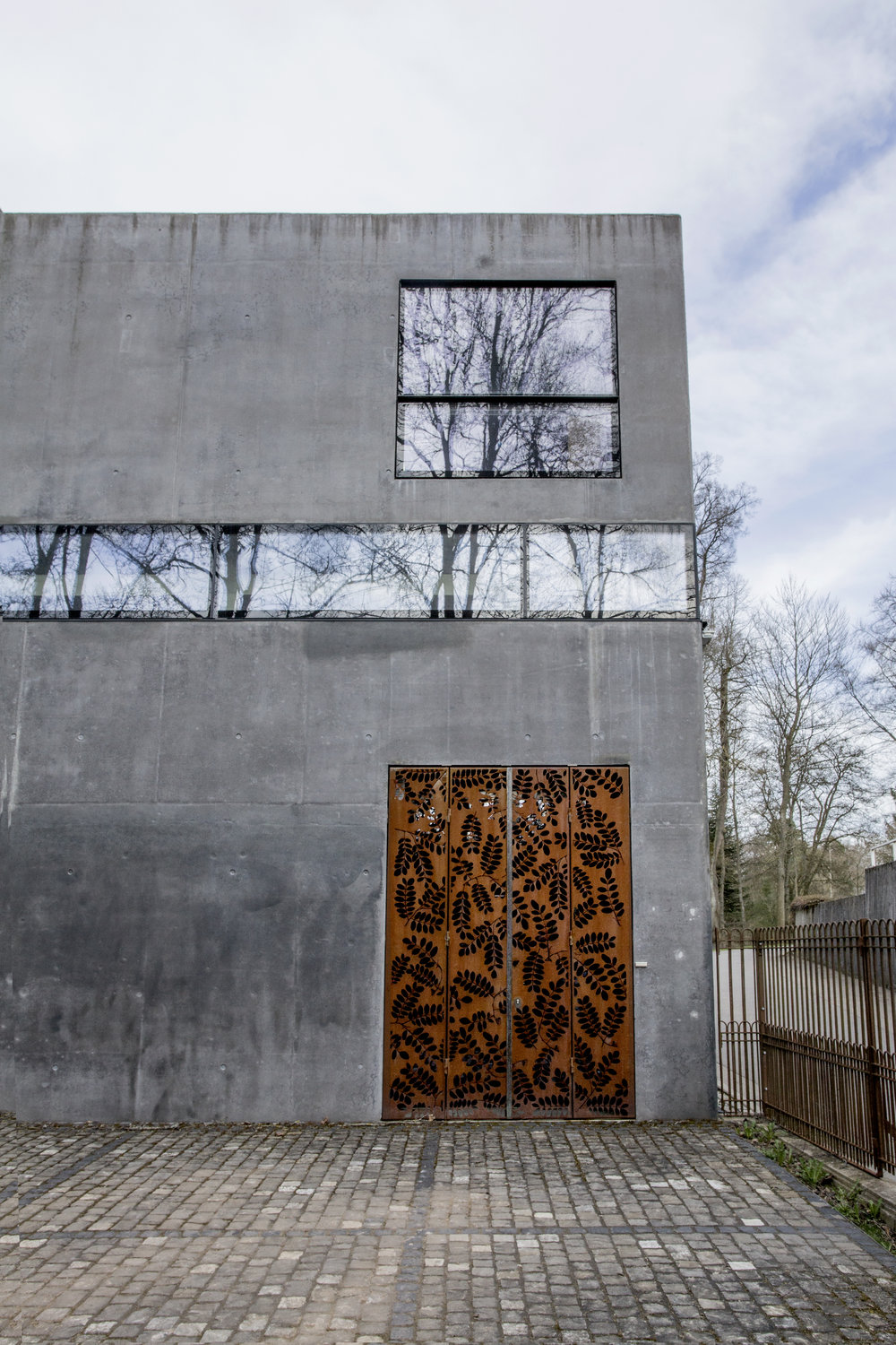 """Sheltered in the museum's new extension, designed by  Lukas Gäbele  and  Tana Raufer in 2009, highlighted by its remarquable """"Gate of the Artworks"""" in rusted iron."""
