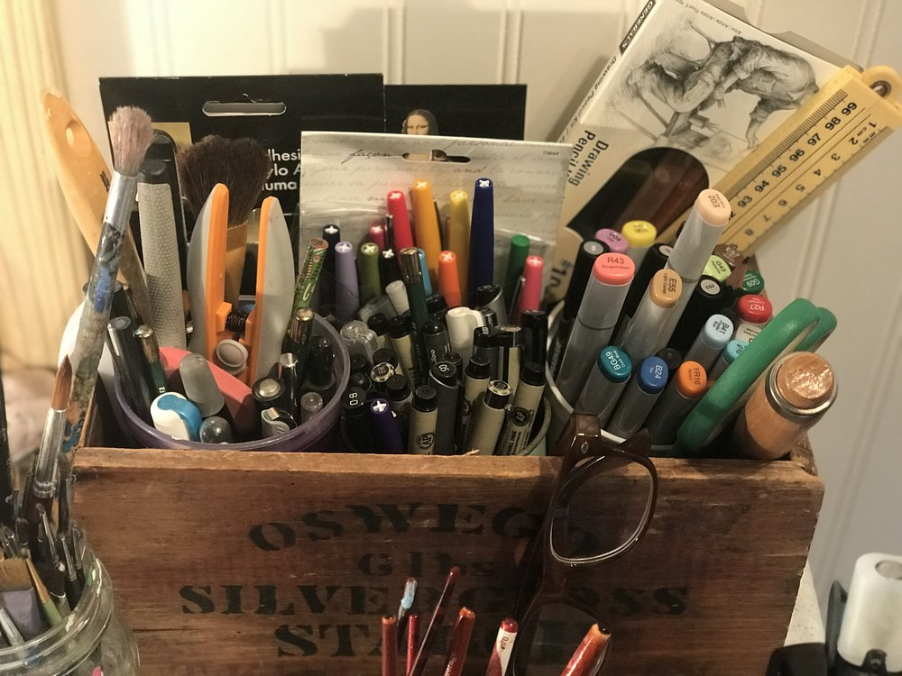 My most favorite wooden box. It sits on my desk and holds many of my daily supplies.