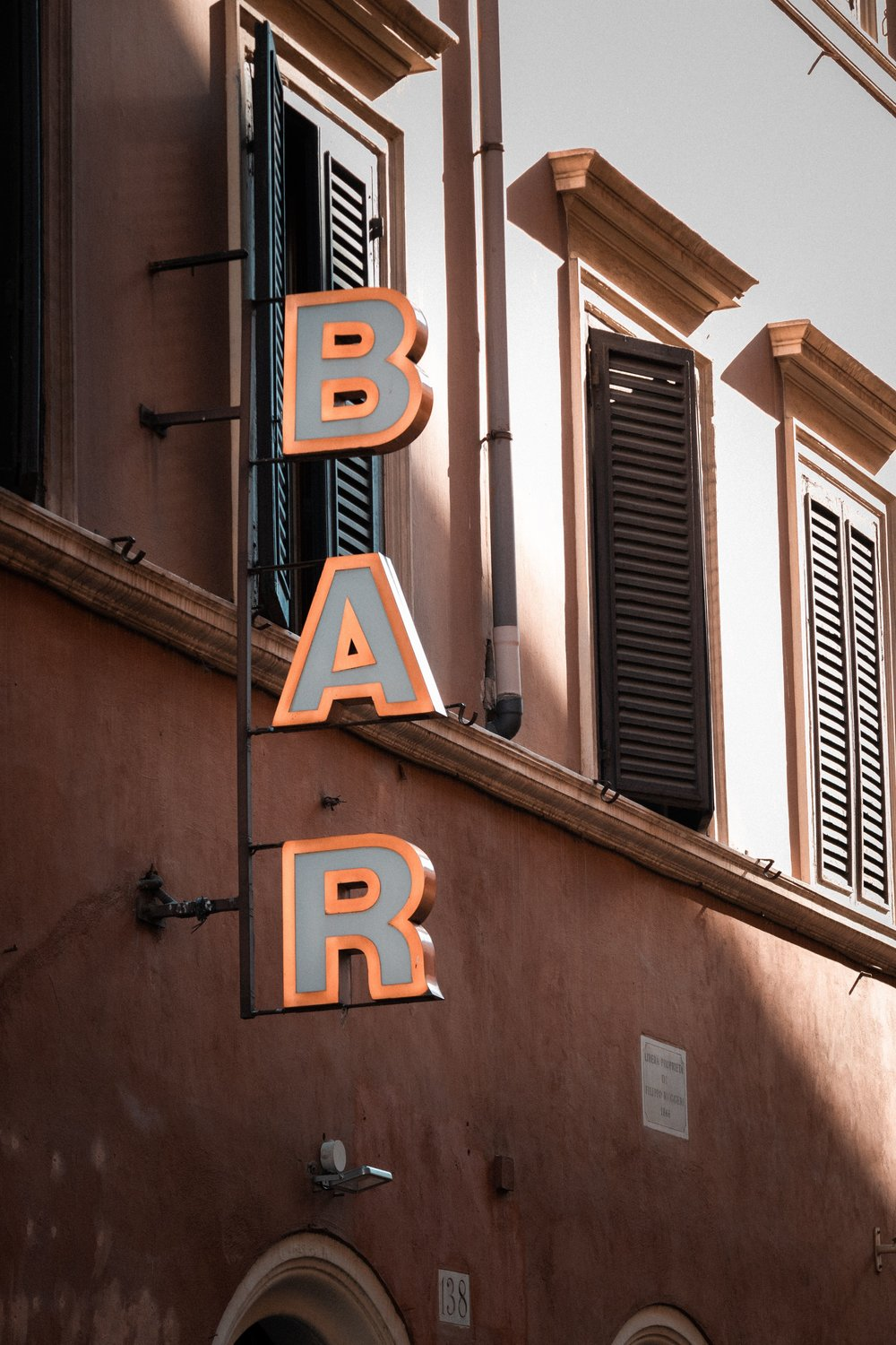 Recognize a cafe by these three letters. Photograph: Daniel Hansen/Unsplash