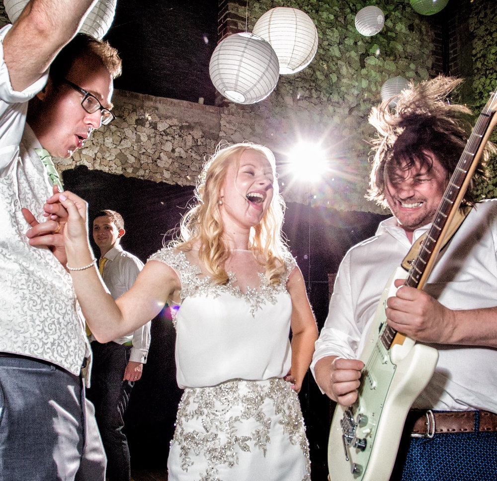 Michael going crazy with his guitar and the bride and groom ecstatic.