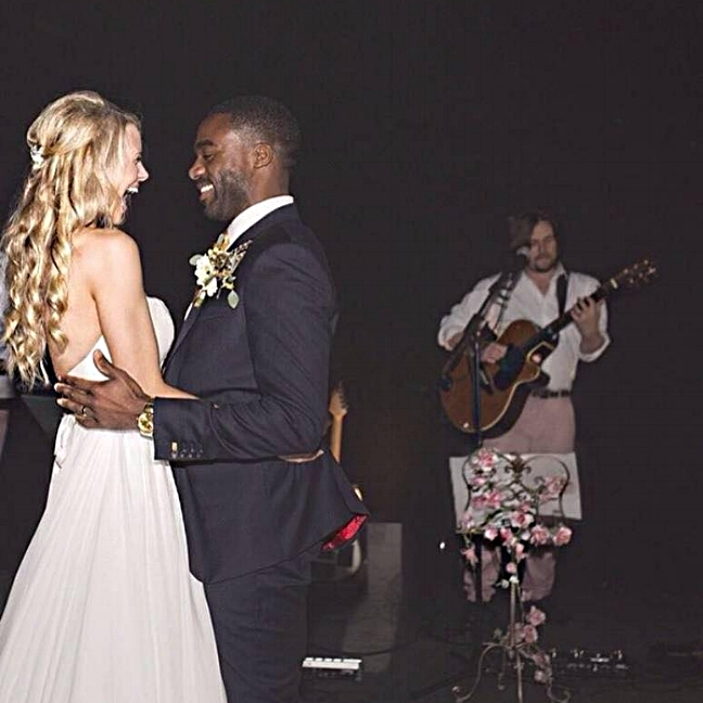 """Ore & Portia Oduba. Penshurst Place, Kent    """"We're so lucky to have found you guys to play at our wedding. Like every couple we hoped to plan the perfect day - it definitely wouldn't have been the day we dreamed of without your incredible performances.      From the minute we spoke on the phone, I knew you'd be able to deliver the perfect setting and atmosphere for our day. But having you provide the soundtrack to our day, especially the beautiful acoustic set, was even more special than we could have imagined.      Our guests were so complimentary… It's testament to how brilliant you set the tone of the party that there wasn't one moment when the dancefloor wasn't packed! People are still talking about the impromptu karaoke moment too - you really had EVERYTHING covered!      We really cannot thank you enough!""""     Photo Credit - Katie Ingram."""
