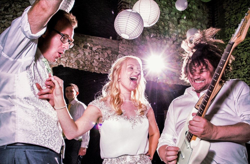 Rocking out on stage with our bride and groom