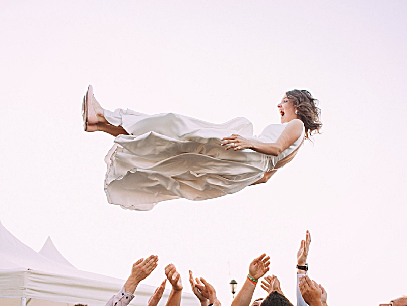 Bride thrown high in the air