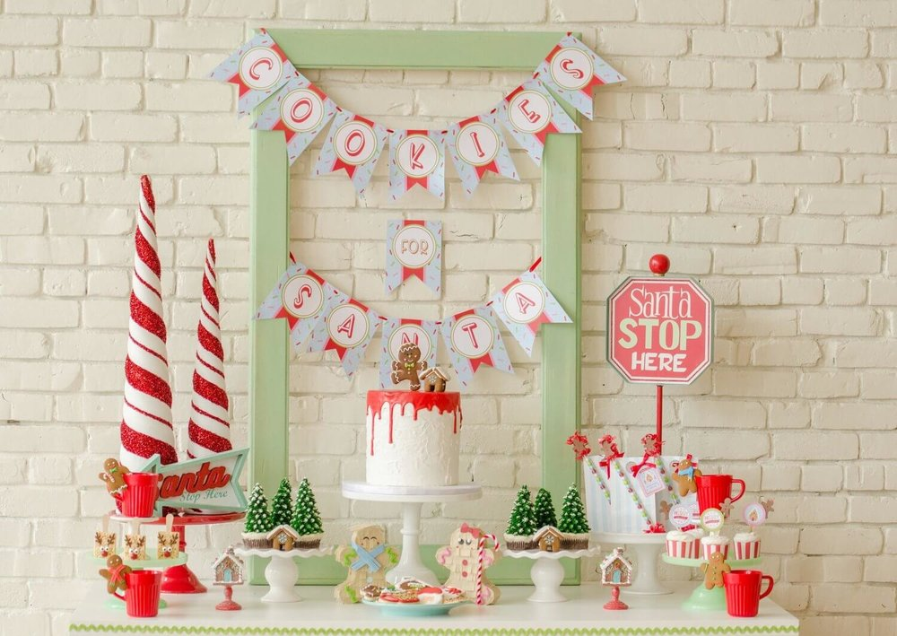 A whole set up for a Cookies for Santa party with cake, printables, dessert ideas and party decor