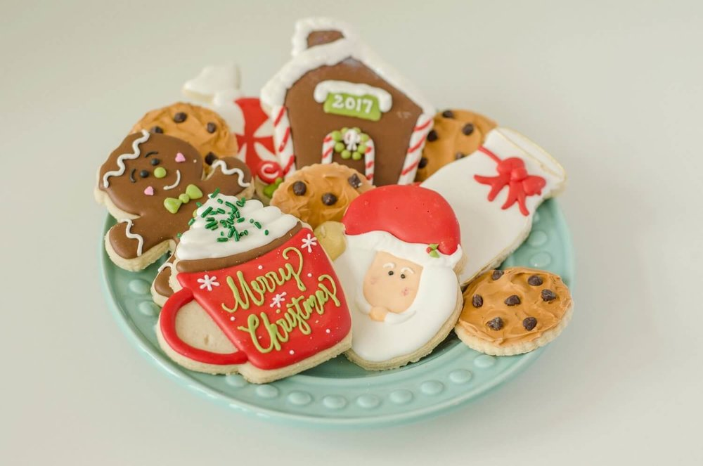 The cutest decorated cookies for a Christmas holiday party See more from this Cookies for Santa party on www.minteventdesign.com - styled by Austin, Texas based party planner Mint Event Design. #holidayparty #holidaypartyideas #christmaspartyideas #christmascookies #holidaydesserts