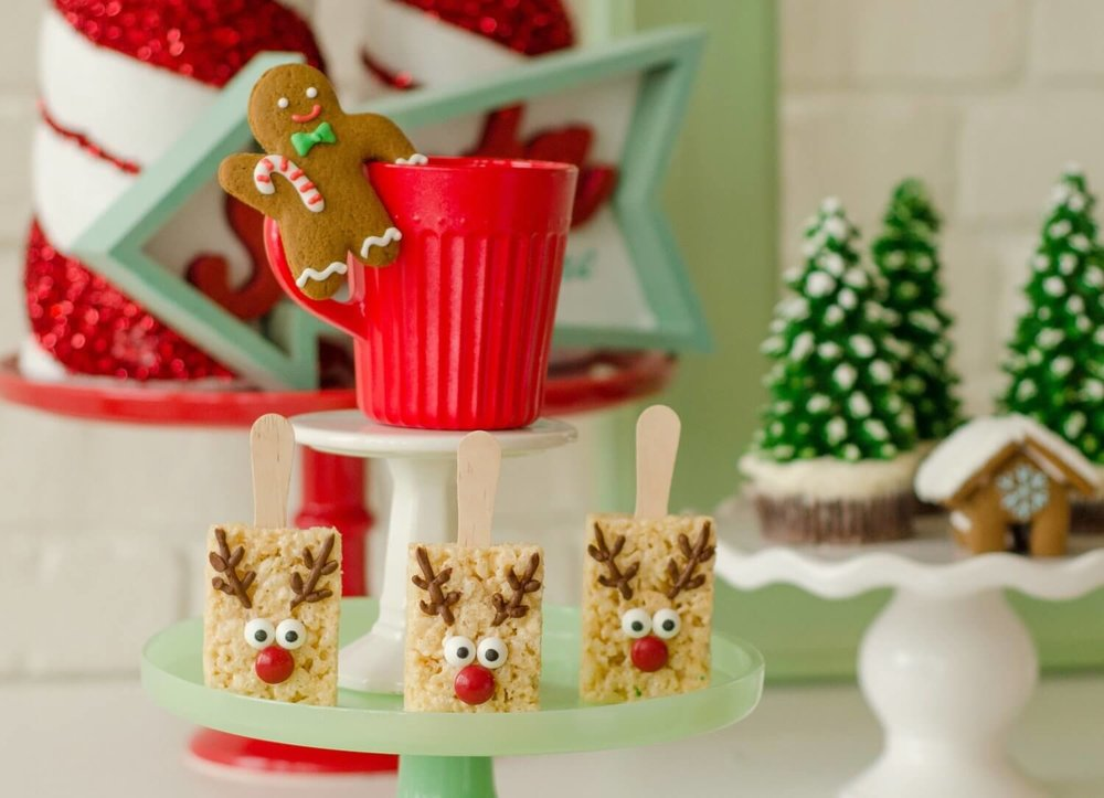 Loving these adorable reindeer rice krispie treats. See more from this Cookies for Santa party on www.minteventdesign.com - styled by Austin, Texas based party planner Mint Event Design. #holidayparty #holidaypartyideas #christmaspartyideas #christmascookies #holidaydesserts