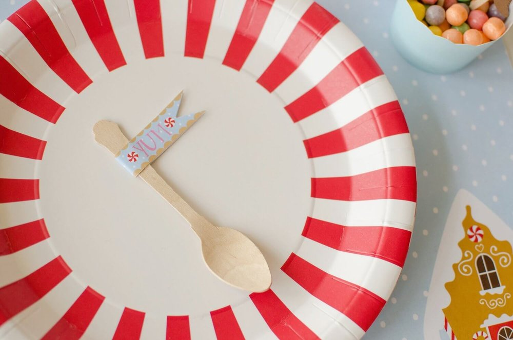 Dress up your party spoons with a Yum printable party flag. See more from this Cookies for Santa party on www.minteventdesign.com - styled by Austin, Texas based party planner Mint Event Design. #holidayparty #holidaypartyideas #christmaspartyideas #partyflags #partyprintables