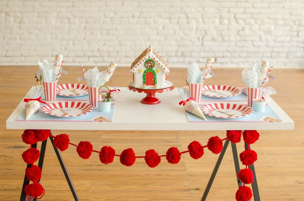 Candy Cane party ware creates the cutest table setting for a Christmas cookie decorating party. See more from this Cookies for Santa party on www.minteventdesign.com - styled by Austin, Texas based party planner Mint Event Design. #holidayparty #holidaypartyideas #christmaspartyideas #christmascookies #cookiedecorating #cookieparty