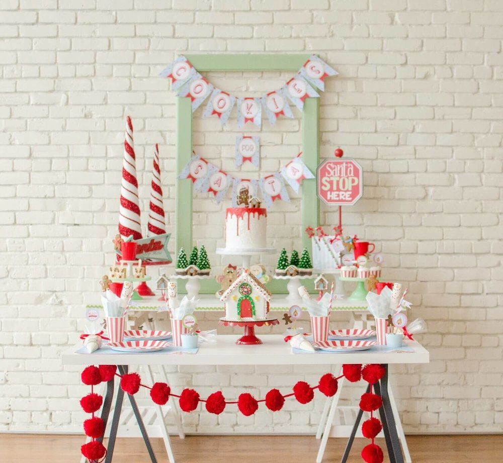 The cutest Christmas Cookie Decorating Party set up with a candy cane patterns and mini gingerbread houses. See more of this Cookies for Santa party on www.minteventdesign.com - styled by Austin, Texas based party planner Mint Event Design. #holidayparty #holidaypartyideas #christmaspartyideas #christmascookies #cookiedecorating #cookieparty