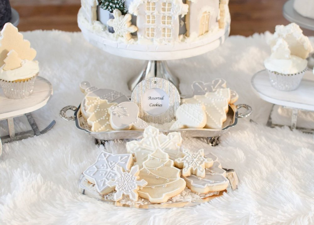 winter bridal shower dessert table with cookies frosted in white and grey icing see more