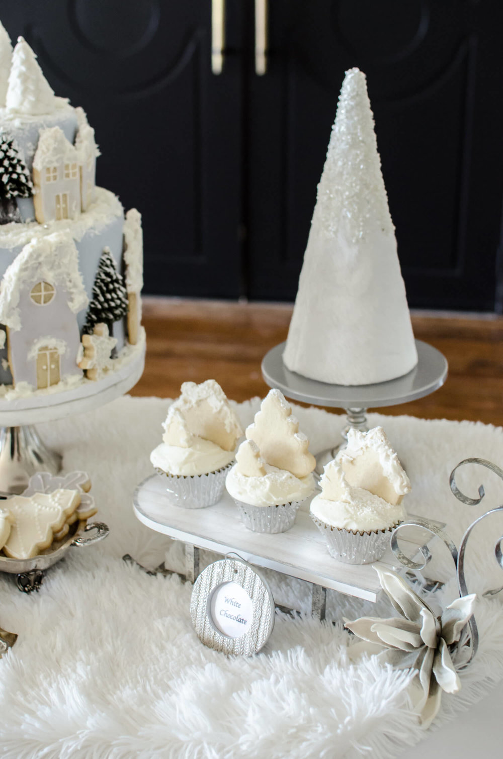 Cute ornament place cards serve as the food labels for this Winter Dessert Table. See more ideas from this Winter Wonderland themed Bridal Shower Inspiration created by Mint Event Design www.minteventdesign.com #winterweddingideas #weddingwedding #bridalshowerideas #winterwonderland #desserttable