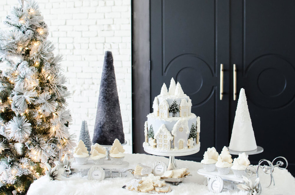 Winter Wonderland dessert table idea including cake, cookies and cupcakes
