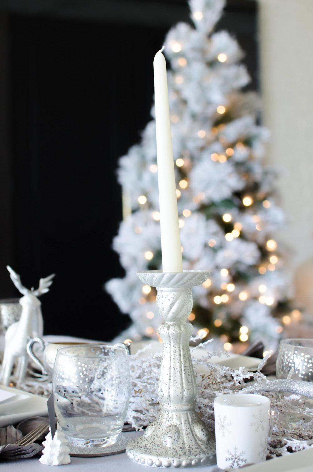 Pretty white and silver details for a winter party tablescape. See more ideas from this Winter Wonderland themed Bridal Shower Inspiration created by Mint Event Design www.minteventdesign.com #winterweddingideas #weddingwedding #bridalshowerideas #winterwonderland #tablescapes