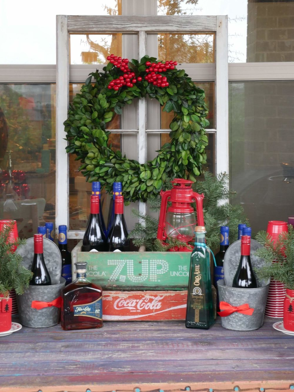Rustic Drink Station for a Christmas party!  Love the green wreath on the vintage window.