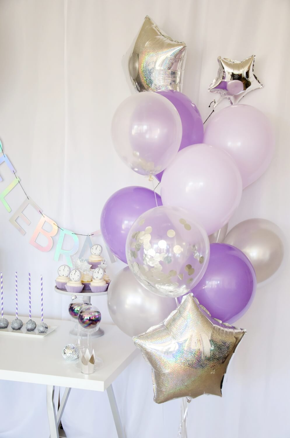 New Years Party decor ideas, love these balloons and the silver and purple combination is adorable too!