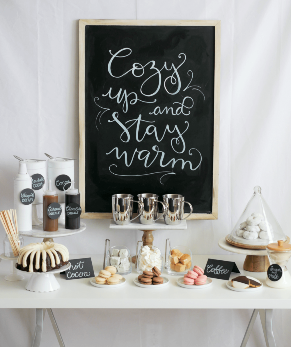 Click to find out how to recreate this pretty and stylish Hot Cocoa and Coffee Bar for your Winter Birthday Parties and Holiday Celebrations. Add a DIY chalkboard sign to complete the look. Styled by party stylist Mint Event Design. #partyideas #partyinspiration #hotchocolate #hotcocoa #coffeebar #coffeestation #winterparty #winterwedding