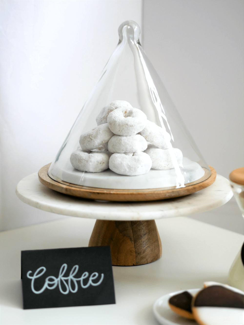 Mini Donuts for a Hot Cocoa Station Dessert. Click for the DIY to recreate your very own Hot Cocoa and Coffee Station. Styled by party stylist Mint Event Design. #partyideas #partyinspiration #hotchocolate #hotcocoa #coffeebar #coffeestation #winterparty #winterwedding #donuts