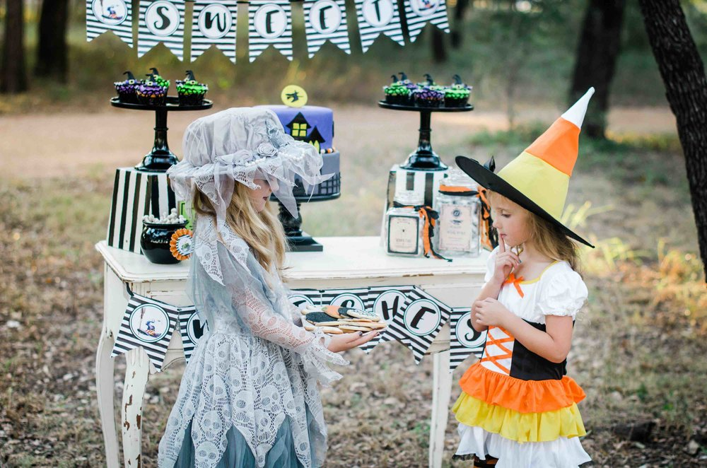 It's a Little Witches' Soiree Halloween Party with so many amazing Halloween Party Ideas including these cute Halloween Costumes for Girls There's a candy corn witch costume and a witch with lace that has skulls all over it. Click to see all the Halloween Party Ideas that you can re-create for your very own Halloween Kids Party. Styled by party stylist Mint Event Design. #halloween #partyideas #partyinspiration #halloweencostumes #candycorn #witchcostume #halloweendecorations