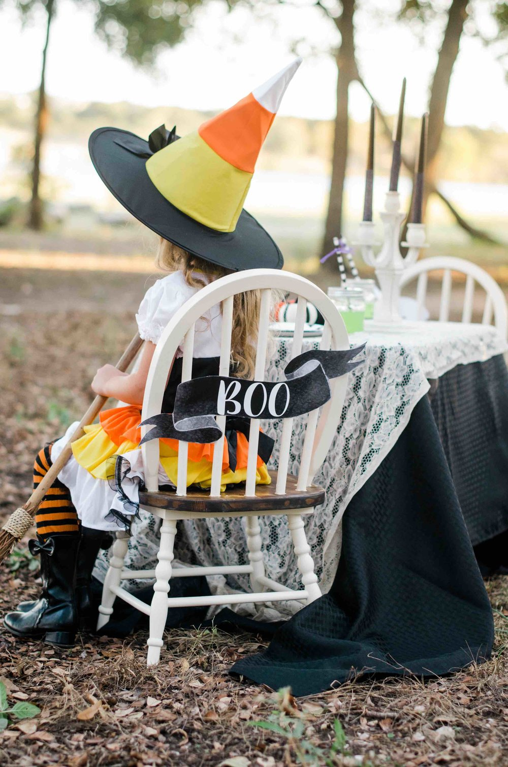 It's a Little Witches' Soiree Halloween Party with one amazing candy corn witch costume. Don't forget to the black boots and a broomstick to make her Halloween Witch costume comes to life. Click to see all the Halloween Party Ideas that you can re-create for your very own Halloween Kids Party. Styled by party stylist Mint Event Design. #halloween #partyideas #partyinspiration #halloweencostumes #candycorn #candycorncostume #witchcostume #halloweendecorations
