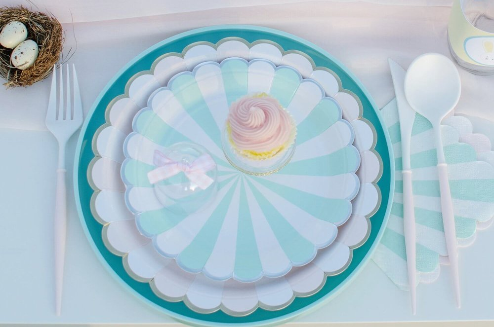 Pretty party paper supplies for an Easter garden party in pink and mint colors with mini cupcakes on a mini cupcake stand. Styling by Mint Event Design www.minteventdesign.com #easterparty #gardenparty #partysupplies #tablescape #eastertable