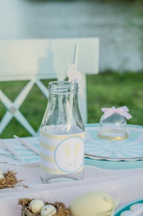 Cute bottle wrappers for the milk bottles add the perfect detail to this Easter Garden Party for Kids. The Easter wrappers are a free download from Mint Event Design www.minteventdesign.com #easterparty #gardenparty #partysupplies #tablescape #eastertable #freeprintable