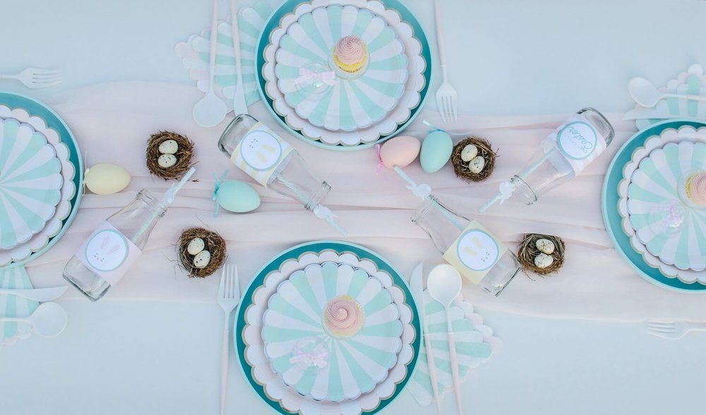 The cutest Easter garden party ideas for kids are here. Including a fun tablescape with ruched fabric for the table runner and mini birds nests with Easter eggs inside. See more Easter Garden Party Ideas for Kids on Mint Event Design www.minteventdesign.com #easterparty #gardenparty #partysupplies #tablescape #eastertable