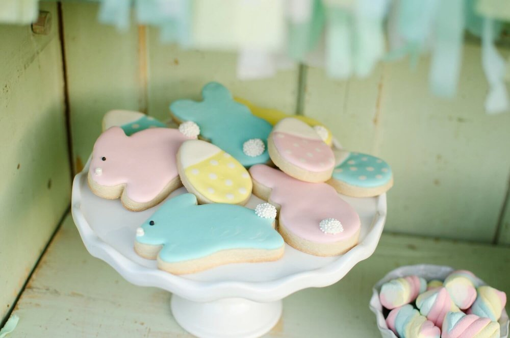 This is the cutest pastel Easter bunny cookies. Look at their little cotton tail. See more Easter Garden Party Ideas for Kids on Mint Event Design www.minteventdesign.com #easterparty #gardenparty #partysupplies #eastercookies #sugarcookies