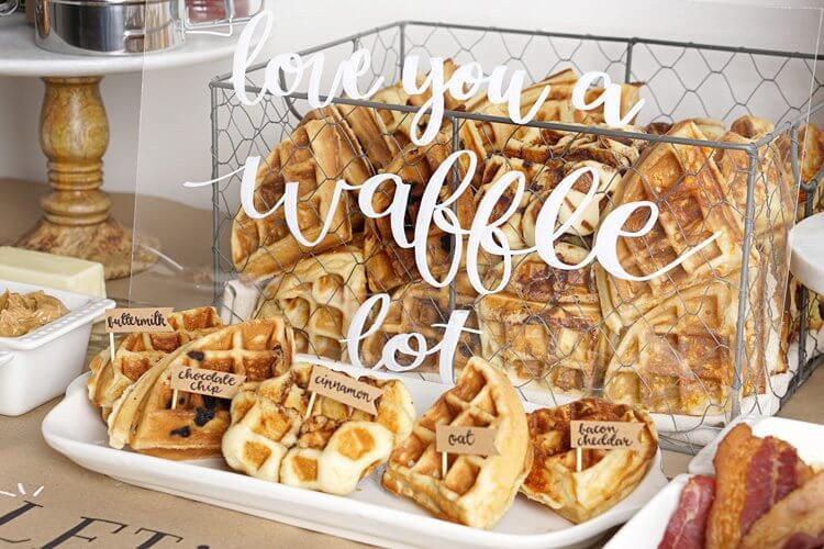 Love You a Waffle Lot - the cutest sign for a Waffle Bar. Little handwritten flags label the waffle flavors to choose from. Find the complete how to guide for setting up a waffle bar on Mint Event Design www.minteventdesign.com #wafflebar #brunch #breakfast #mothersday #brunchideas #partyideas