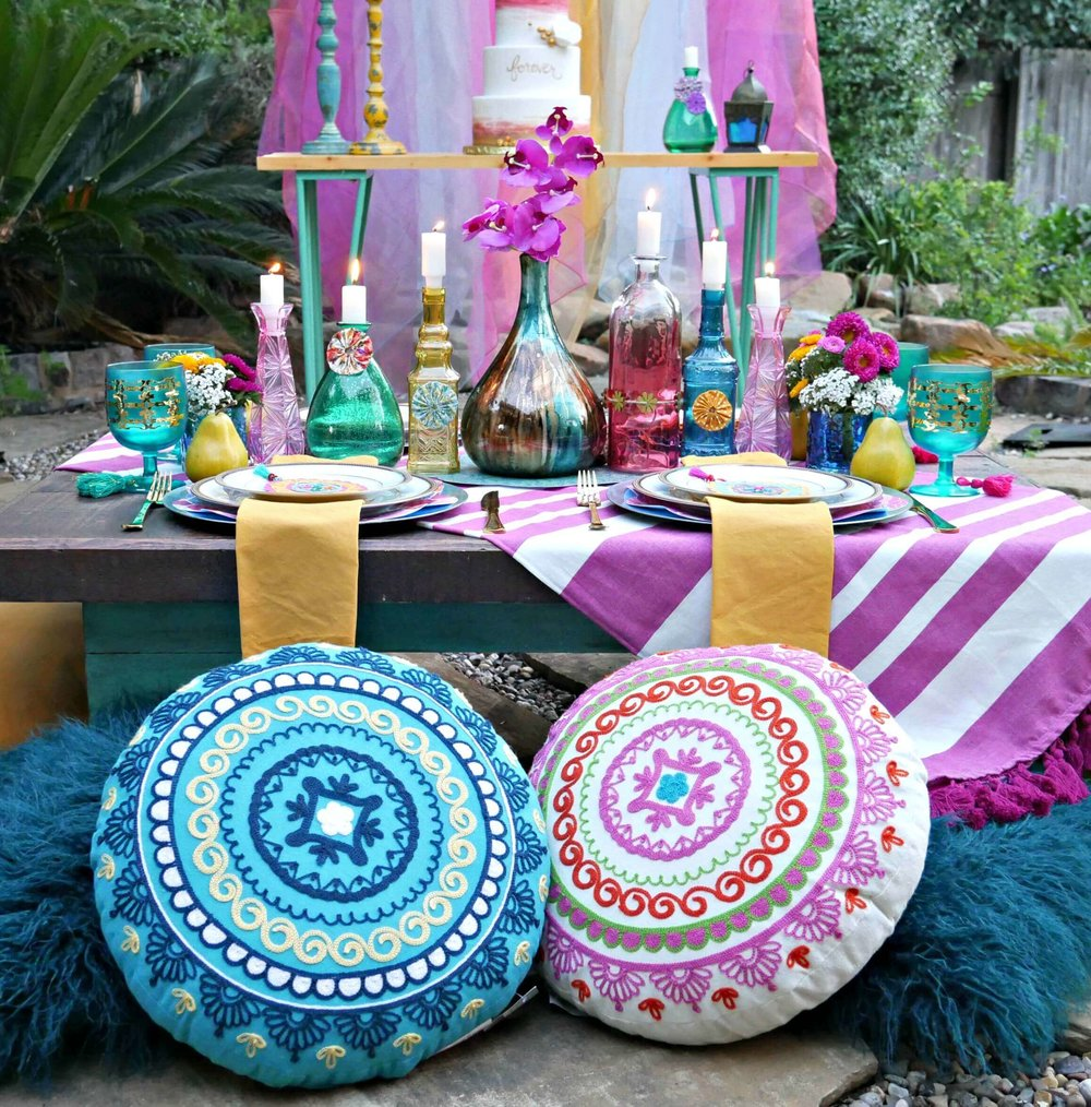 Creative Idea for a boho chic engagement party: Plush pillows and low tables for a relaxed and romantic dinner. Styled by Mint Event Design in Austin Texas www.minteventdesign.com #engagementideas #tablesetting #tablescapes #bohochic