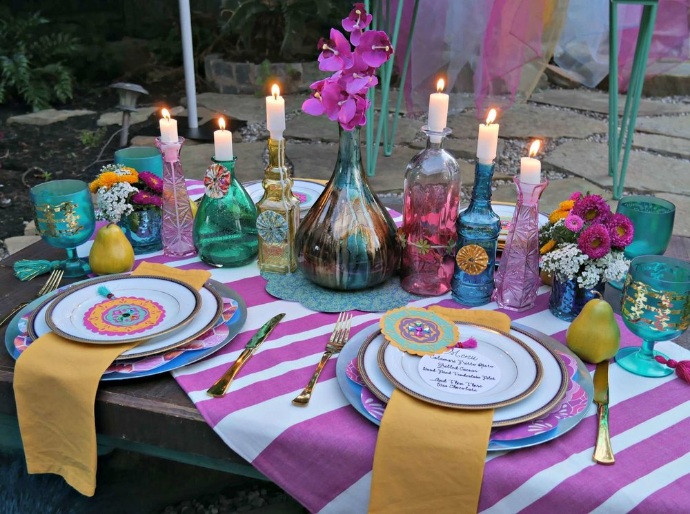 Love the idea of mixing all different jewel toned colors together for a boho chic engagement party. Styled by Mint Event Design www.minteventdesign.com #engagementparty #tablesetting #tablescapes #bohochic