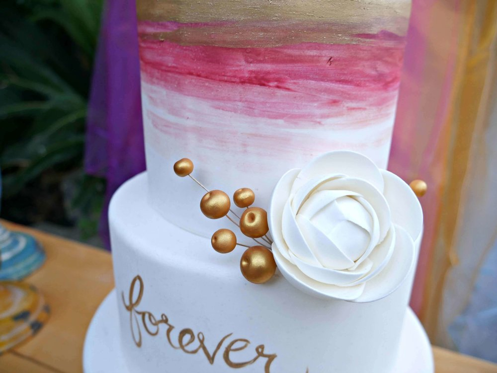 This pretty Watercolor Ombre cake is perfect for a bohemian style gypsy party themer. Created by Michelle's Patisserie and styled by party planner Mint Event Design in Austin Texas www.minteventdesign.com #caketable #weddingcake #weddingcakes #bohochic #watercolorcake