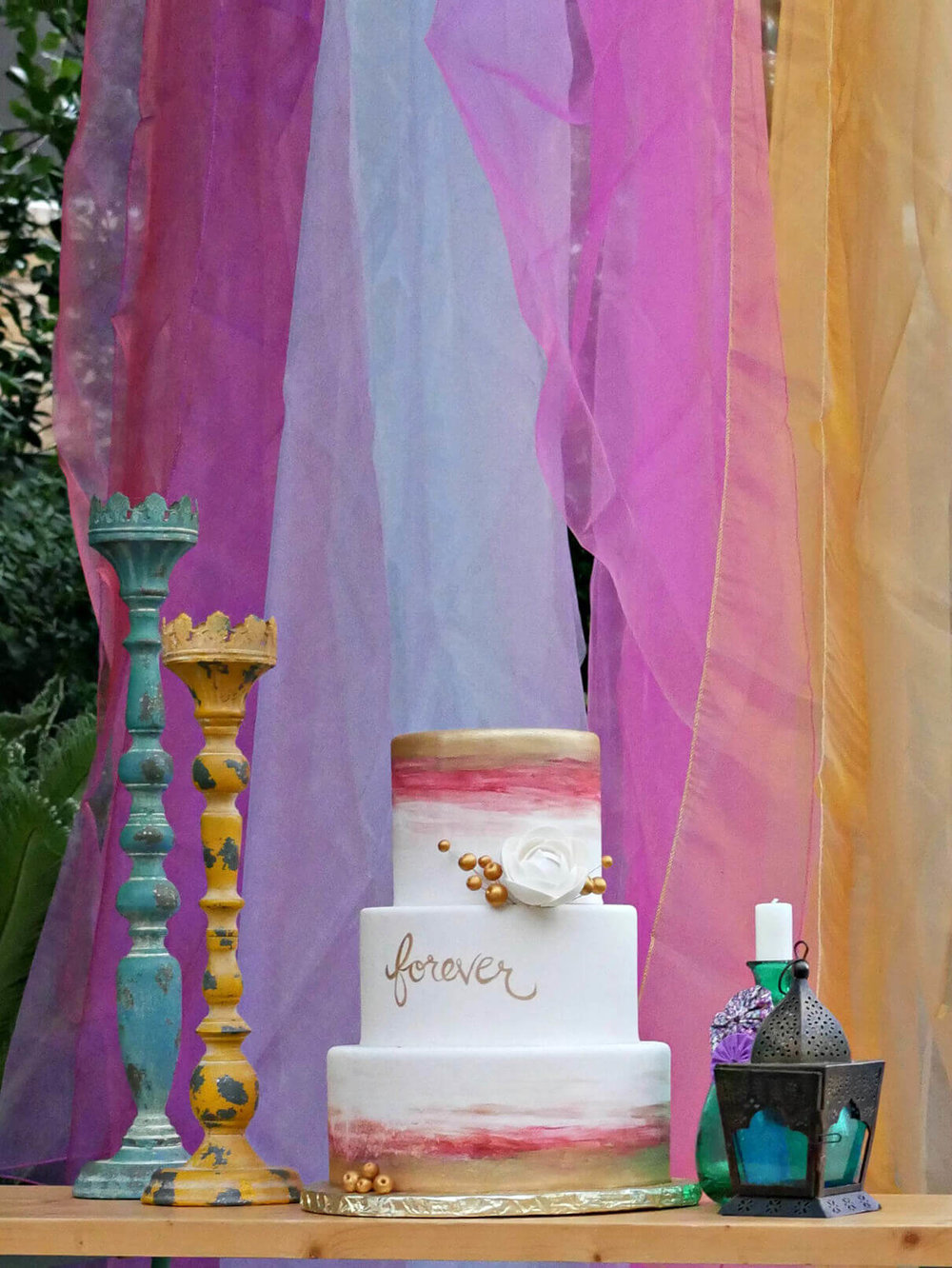 Watercolor cake created by Michelle's Patisserie and styled by Mint Event Design in Austin Texas www.minteventdesign.com #caketable #weddingcake #weddingcakes #bohochic #watercolorcake