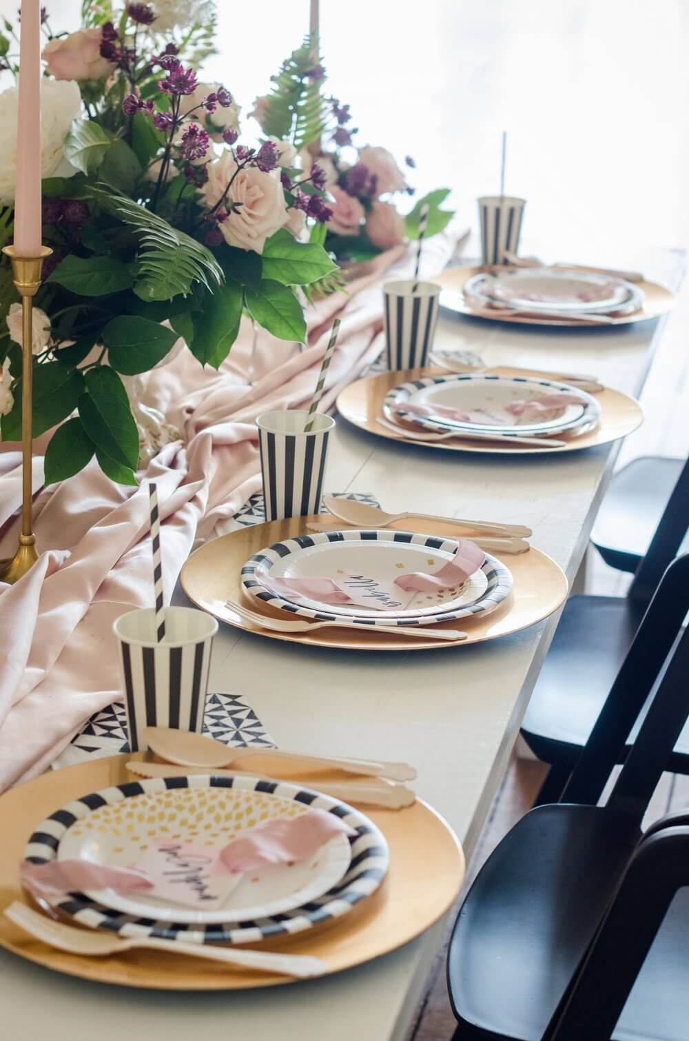 Beautiful table setting for a bridal shower with blush pink accents