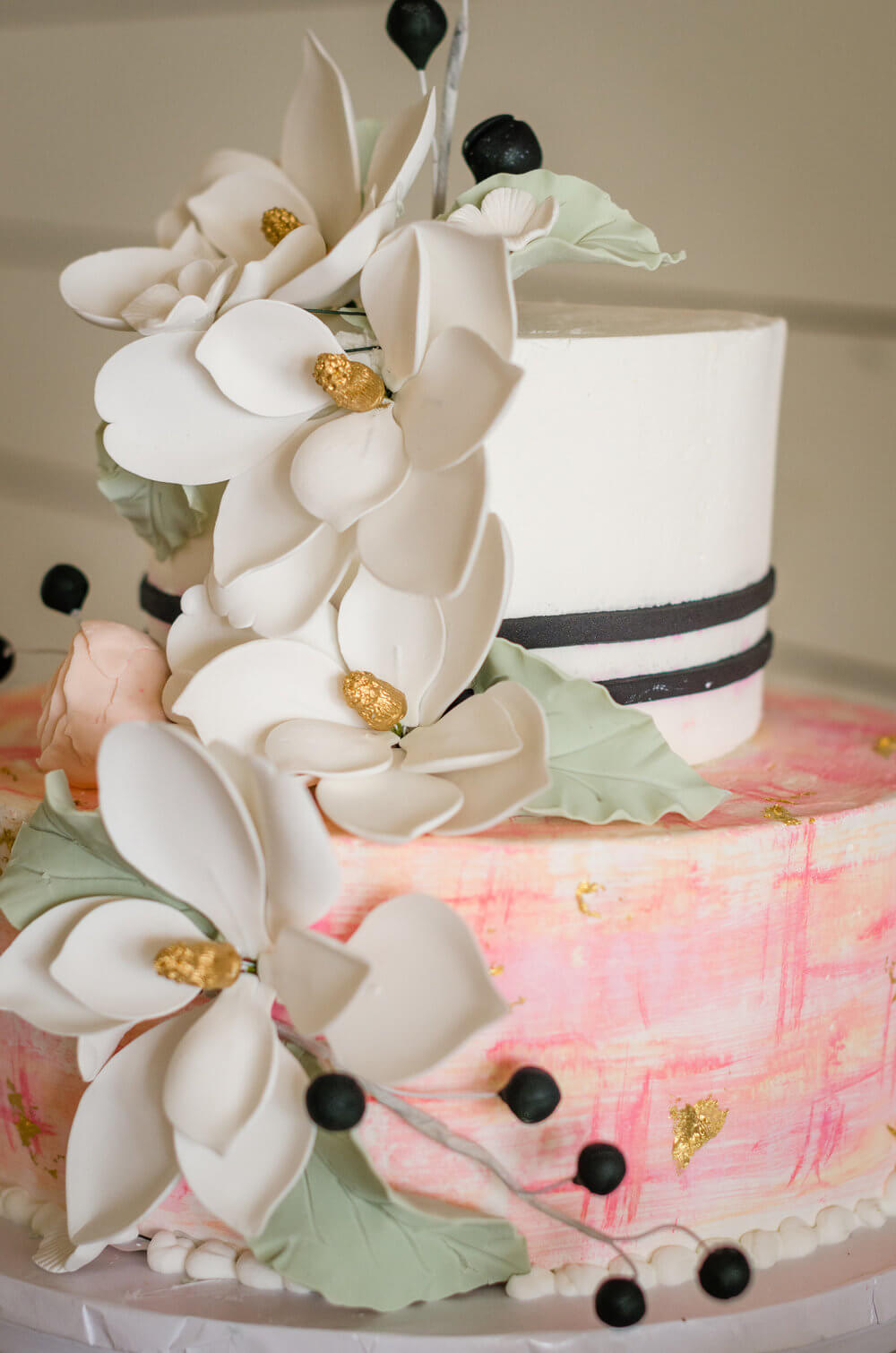 Pink and black cake with watercolor accents