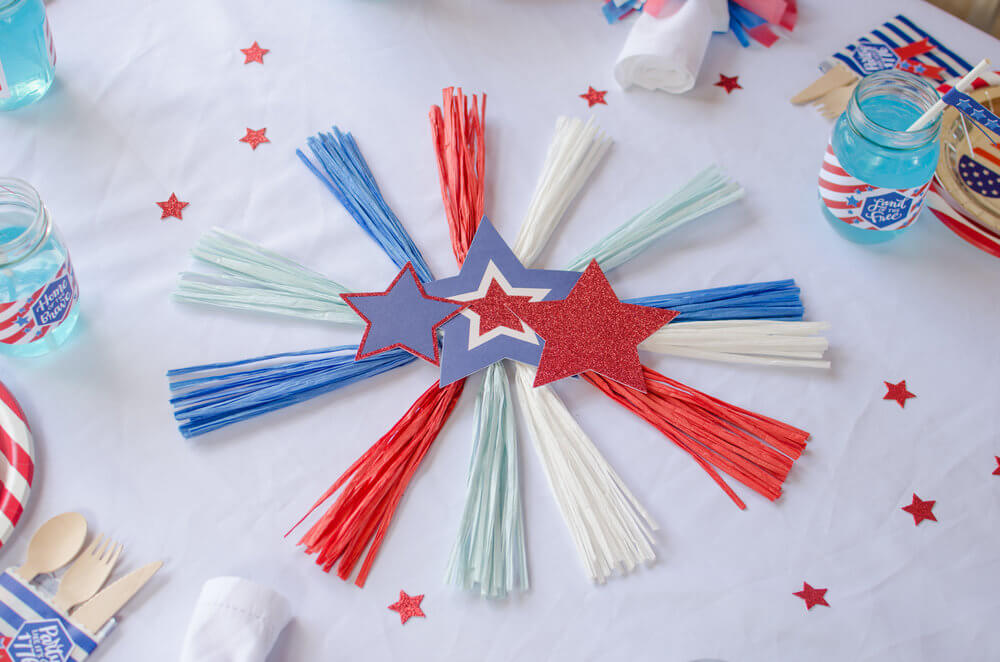 Fun fireworks craft of streamers and stars to decorate the table.