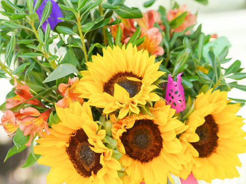 Beautiful sunflowers and greenery were so bright and cheerful at this party.