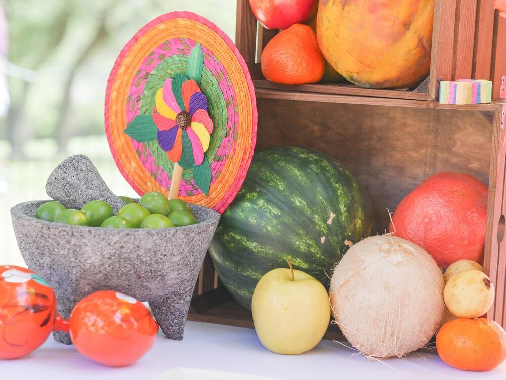Traditional Mexican decor was sprinkled among fresh fruits and veggies on the dessert table.