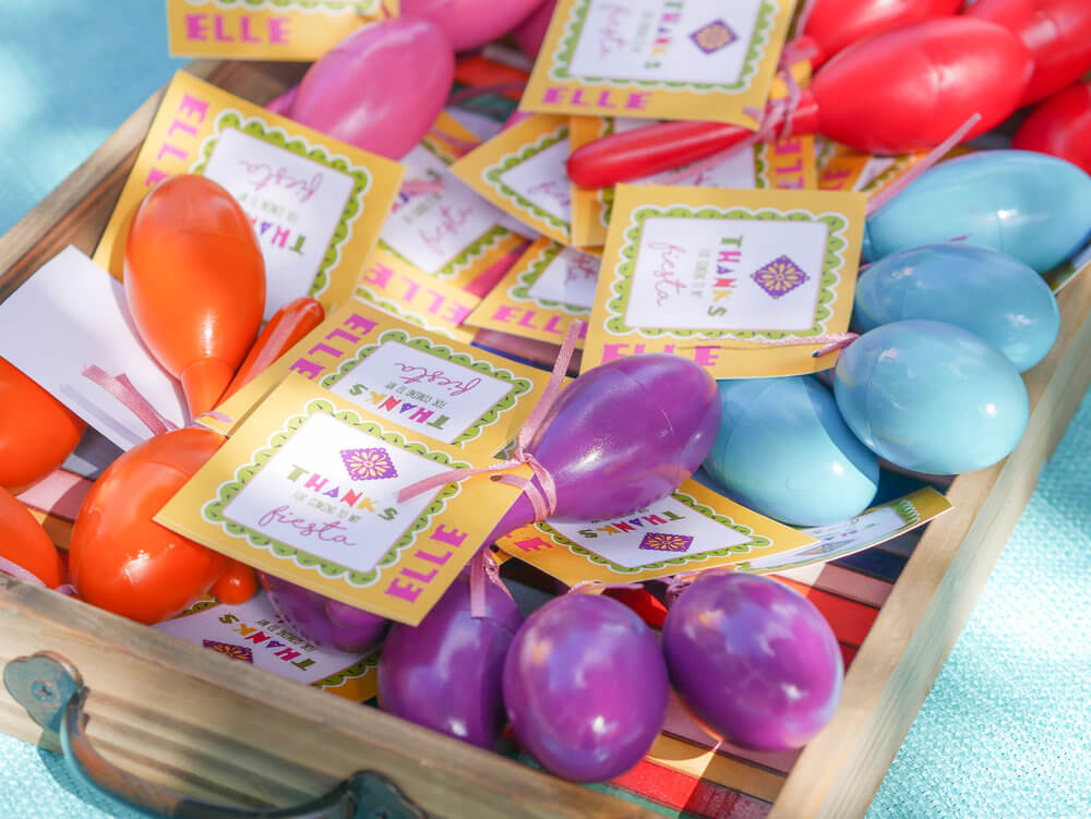 Maracas are perfect colorful party favor for a fiesta themed birthday party - thanks for coming to my fiesta. Party Styling by Austin Texas party planner Mint Event Design www.minteventdesign.com #kidsbirthdayparty #fiestaparty #disneycoco #partyideas #girlbirthdayparty #cocobirthdayparty #partyfavors