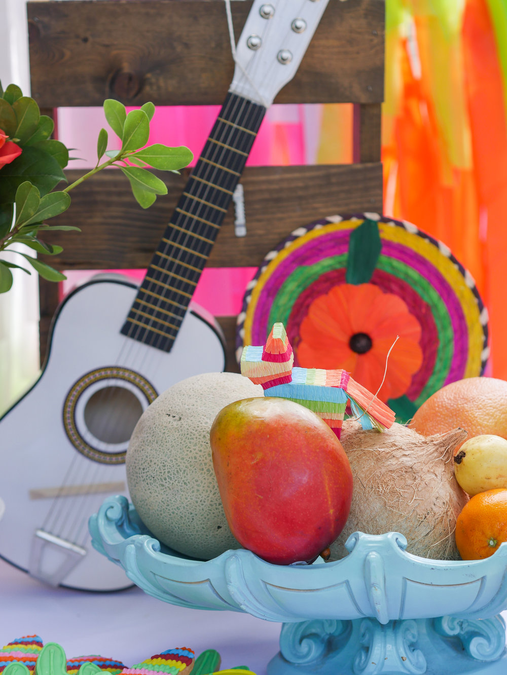 Fiesta Party Planning Tip: Create edible displays as party decor. This Coco inspired birthday party features mini guitars like the one in the movie along with fresh fruits and vegetables. Party Styling by Austin Texas party planner Mint Event Design www.minteventdesign.com #kidsbirthdayparty #fiestaparty #disneycoco #partyideas #girlbirthdayparty #cocobirthdayparty