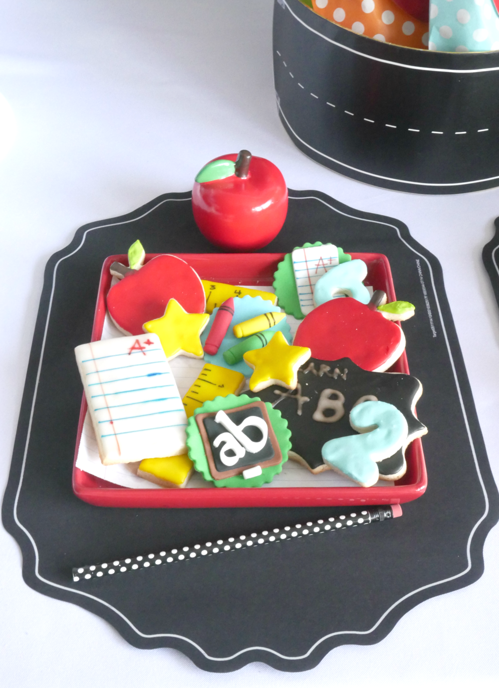 Detailed frosted cookies perfect for a back to school party, cookies shaped like apples numbers letters and more