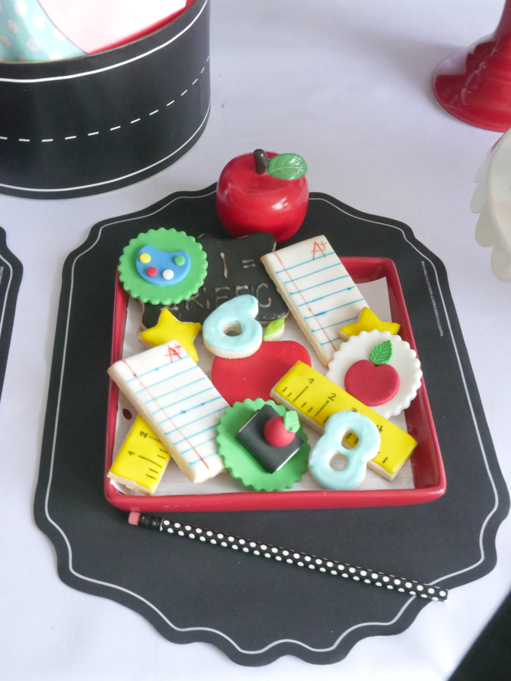 Beautifully decorated sugar cookies for a back to school party, cookies shaped like apples numbers letters and more