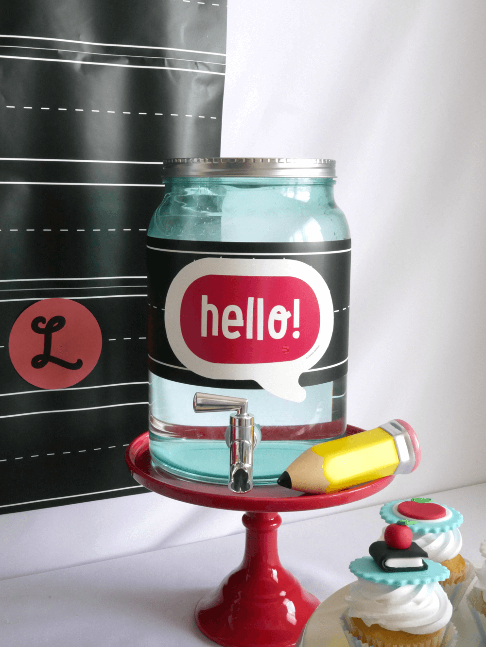 Mason Jar themed beverage dispenser at a back to school party with a chalkboard tag and cute pencil decorations. Great for a back to school drink station #Backtoschoolparty