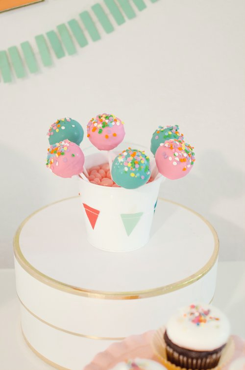 Birthday Party Cake Pops presented on a hat box instead of the typical cake stand / Click to see even more surprising ways to greet your guests at a Birthday Party / Styled by Carolina from MINT Event Design / www.minteventdesign.com #birthdayparty #partyideas #partyinspiration #partydesserts #cakepops #partydessert