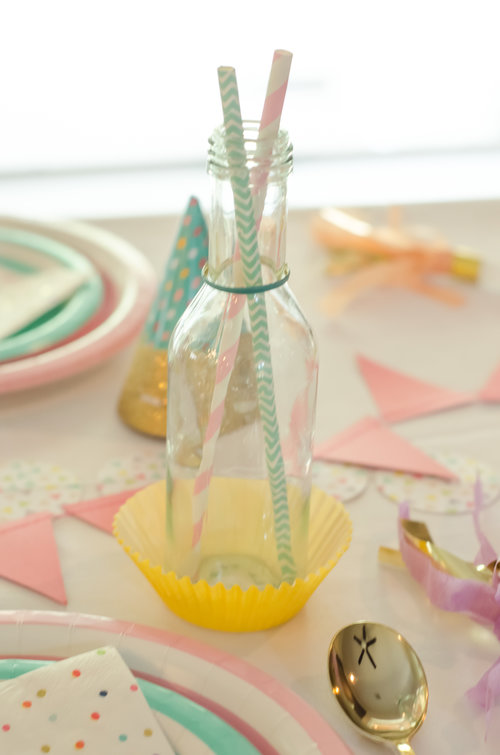 Unexpected details are fun for your guests - like this drink glass with two straws and a cupcake liner coaster / Click for more birthday party ideas on the blog along with surprising ways to greet your guests at a Birthday Party / Styled by Carolina from MINT Event Design / www.minteventdesign.com #birthdayparty #partyideas #partyinspiration #partydrinks #partydetails