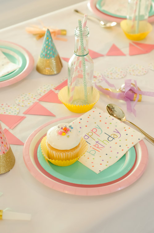 It's so fun to have unexpected details for your guests - like this drink glass that features two straws and a cupcake liner coaster / Click for more birthday party ideas on the blog along with surprising ways to greet your guests at a Birthday Party / Styled by Carolina from MINT Event Design / www.minteventdesign.com #birthdayparty #partyideas #partyinspiration #partydrinks #partydetails